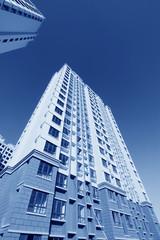 unfinished color building, under the blu sky