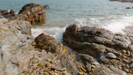Waves crashing onto the rocks.