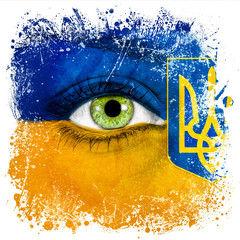 Ukraine flag painted over female face