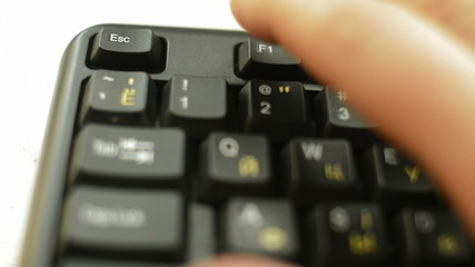 finger presses the Escape key on your keyboard