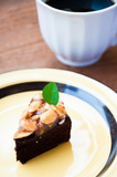 Close up image of walnut toffee cake with coffee