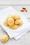 cookies with almonds on a white plate