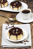 Delicious donut with chocolate on wooden table