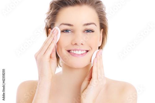 Woman cleaning face - 62358250