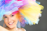 Fashionable woman in a colorful hat
