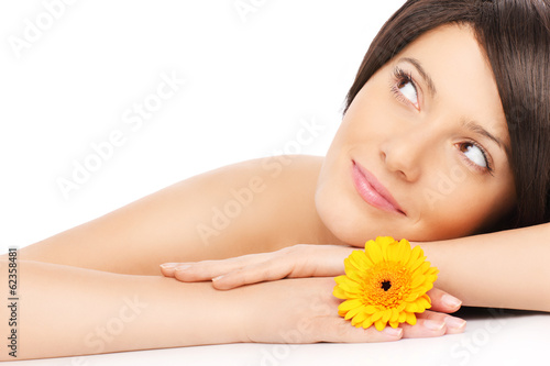 Woman relaxing with a flower