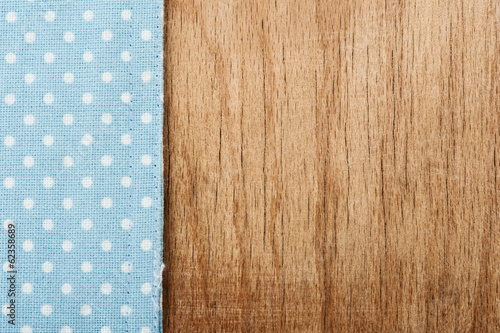 Tablecloth and wooden table background