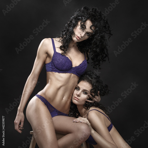 canvas print picture Lesbian play. Two beautiful girls in love foreplay