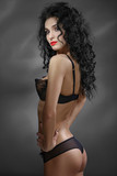 Portrait of sexual girl. Long black hair curls. Perfect body.