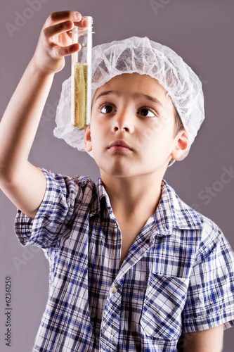 little male child have experiment with test tubes