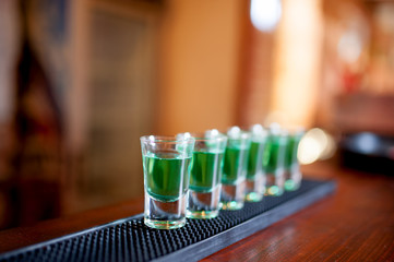 alcoholic shots of different drinks at a party in a nightclub