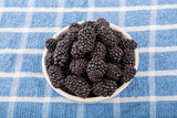Bowl of Blackberries on Blue Towel