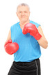 Male boxing coach holding guard