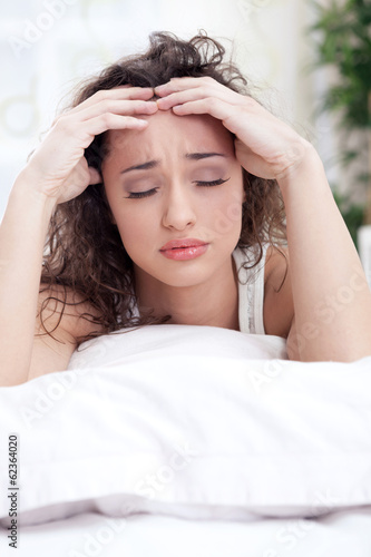 Beautiful woman having a headache