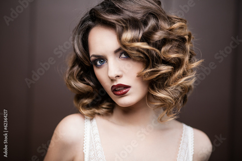 Beauty styled closeup portrait of a young woman - 62364217