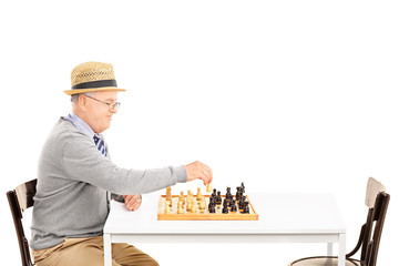 Senile old man playing a game of chess alone