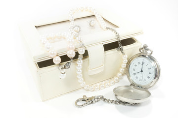 Pearl necklace and pocket watch