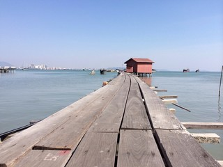 A plank walkway made from stilt leading to a fisherman's hut