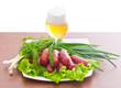 grilled sausages with herbs and beer