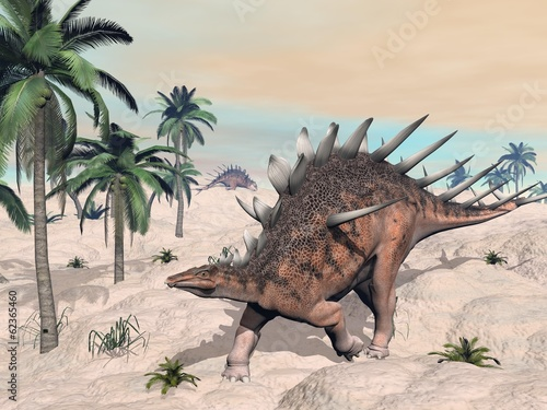 Kentrosaurus dinosaurs in the desert - 3D render