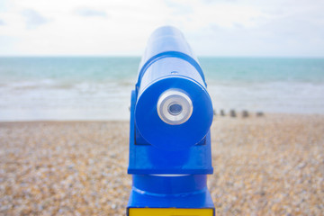 telescope viewfinder at the beach looking out to sea