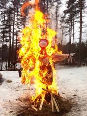 Carnival scarecrow idol burning