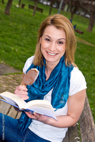 attractive woman on the bench with book