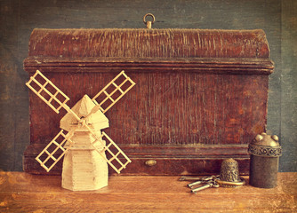 Vintage wooden boxes and model windmill. retro concept