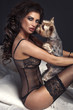 Sexy beautiful brunette woman posing with dog.