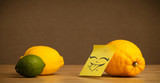 Lemon with post-it note sticking out tongue to citrus fruits