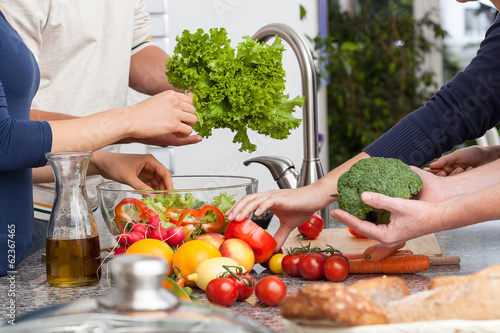 Friends making a salad
