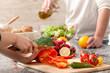 Leinwanddruck Bild - Cutting a vegetables for salad