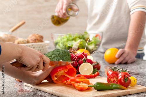 Leinwanddruck Bild Cutting a vegetables for salad