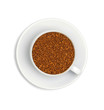 granules of instant coffee in a white cup and saucer isolated on