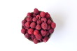 Fresh raspberries in a bowl on a white background