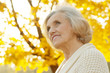 Beautiful elderly woman at nature