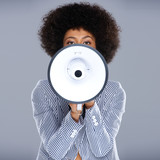 African American woman speaking into a megaphone