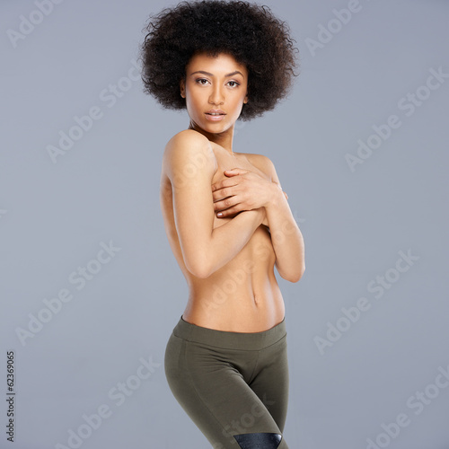 Topless provocative African American woman
