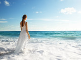 young woman standing in sea waves