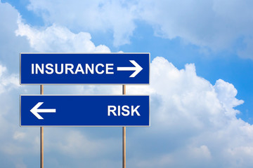 Insurance and risk on blue road sign