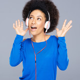 Beautiful African American woman enjoying music