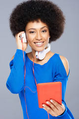 Beautiful Afro-American woman listening to music