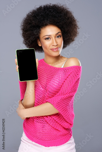 Smiling African American woman with a tablet-pc