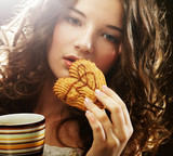 woman with coffee and cookies