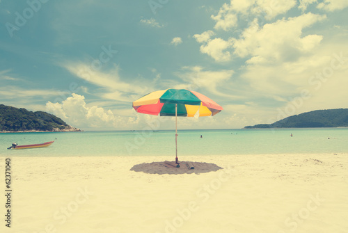 Vintage retro beach with umbrella