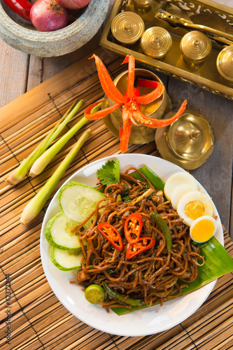 asian fried noodle with traditional background