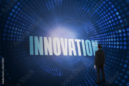 Innovation against futuristic dotted blue and black background