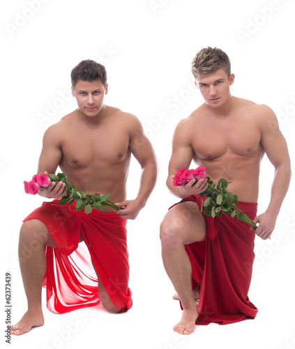 Sexy guys posing with roses, isolated on white