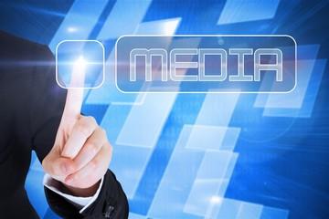 Businesswomans finger touching Media button