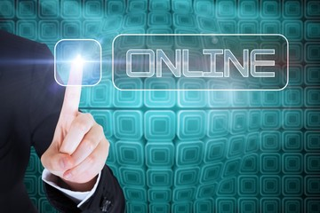 Businesswomans finger touching Online button